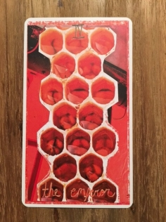 Image: emperor card, depicting a honeycomb with larvae inside.